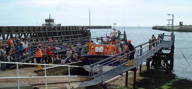 Lifeboat and the Entrance to the Port of Shoreham (Photograph by Ray Hamblett)