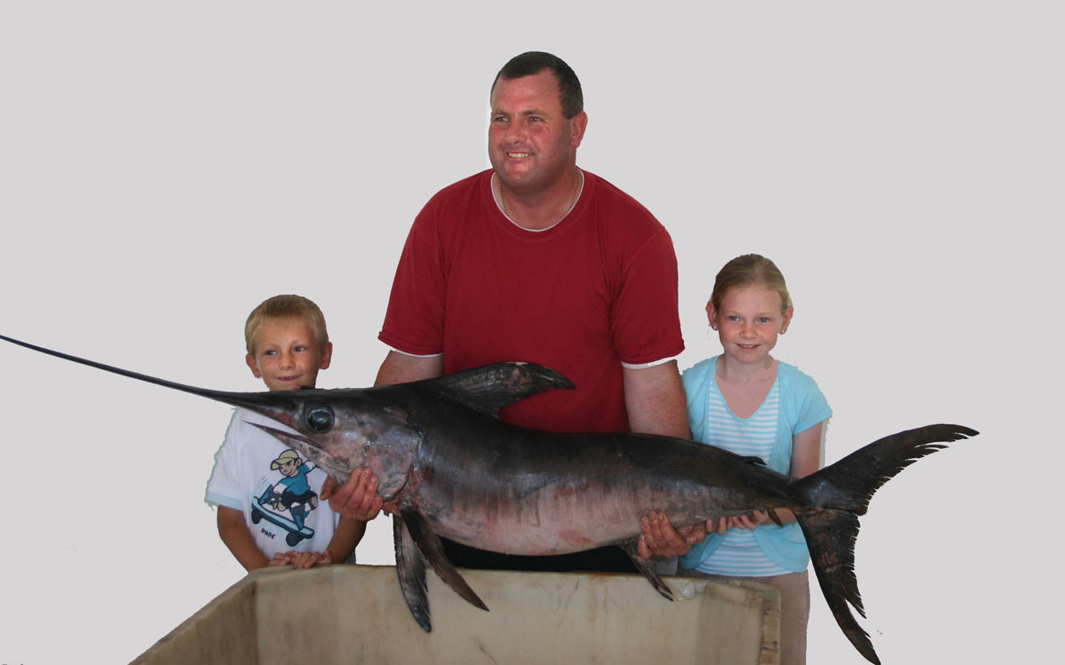 Peter Dent (with Phillip and Imogen) and the Swordfish (Photograph by Alan Charlton)